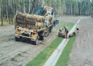 Photograph of turf being laid.
